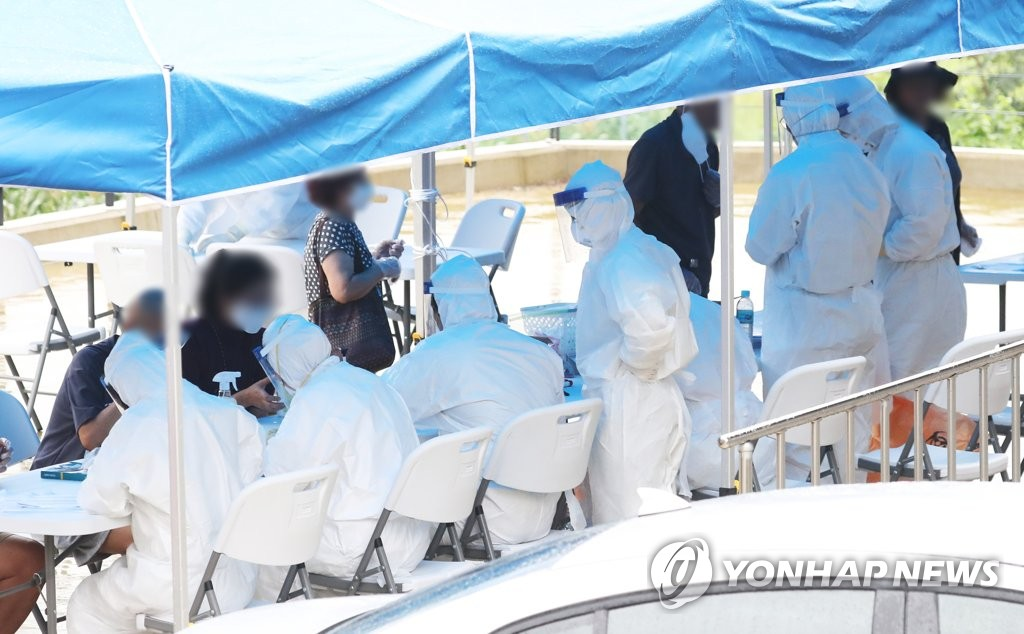 S.Korea accuses church pastor as COVID-19 cases surge