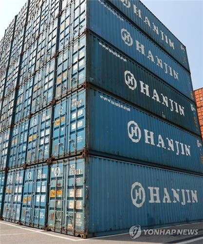 Hanjin Shipping Co.'s container boxes are stacked at a port yard in Busan on Sept. 1, 2016. (Yonhap)