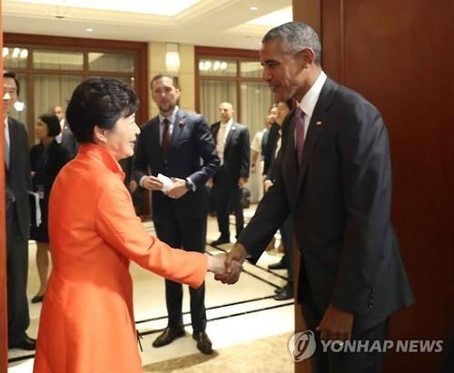 President Park Geun-hye (L) shakes hands with U.S. President Barack Obama before their talks on the sidelines of a series of summits with the Association of Southeast Asian Nations in Vientiane, Laos, on Sept. 6, 2016.