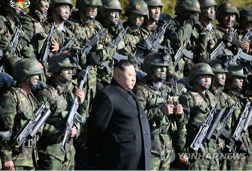 In this photo taken on Dec. 11, 2016, North Korean leader Kim Jong-un oversees a drill containing a simulation of striking the presidential house Cheong Wa Dae and other core facilities in South Korea, along with special operations troops in North Korea. (For Use Only in the Republic of Korea. No Redistribution) (Yonhap)