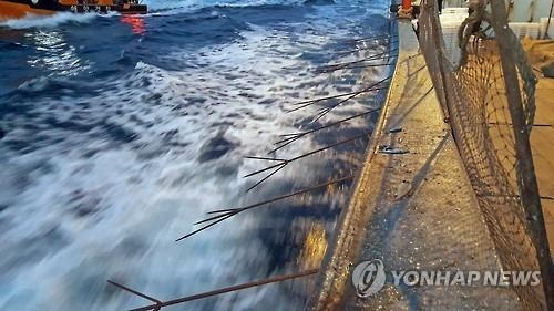 This undated file photo shows a Chinese boat armed with iron spears illegally fishing in South Korean waters. (Yonhap)