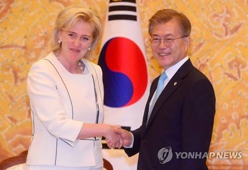 South Korean President Moon Jae-in (R) shakes hands with Princess Astrid of Belgium at the presidential office Cheong Wa Dae in Seoul on June 13, 2017. (Yonhap)