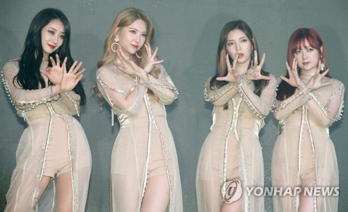 Members of K-pop girl group Nine Muses pose for the camera at a media event for its new album on June 19, 2017, at the Yes24 Live Hall in northwestern Seoul. (Yonhap)