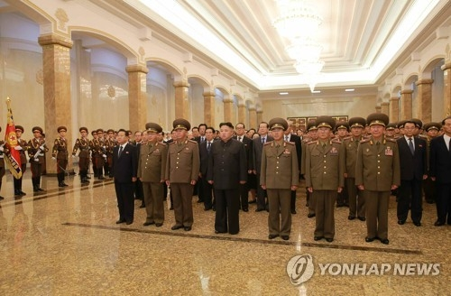 In this photo, provided by the Korean Central News Agency (KCNA), North Korean leader Kim Jong-un, 4th from L in front row, stands abreast with key officials at the Kumsusam Memorial Hall to pay respects to Kim Il-sung, his grandfather and late founder of the regime, on the 23th anniversary of his death, on July 8, 2017. (Yonhap)