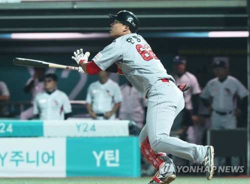 In this file photo taken on May 31, 2017, Han Dong-min of the SK Wyverns watches his three-run home run against the KT Wiz in the teams' Korea Baseball Organization game at KT Wiz Park in Suwon, Gyeonggi Province. (Yonhap)