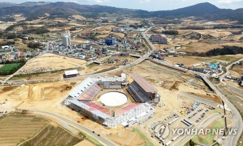 "This is an aerial view of a stadium, dubbed ""Olympic Plaza,"" under construction where the opening and closing ceremonies of the 2018 PyeongChang Winter Olympic Games will be held. The facility is scheduled to be completed by the end of August. (Yonhap)"