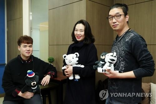 The creators of the mascots for the 2018 PyeongChang Winter Olympics and Paralympics pose for a photo at Mass C&G in Sangam-dong, western Seoul, on Feb. 13, 2018. (Yonhap)