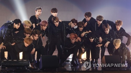 "In this file photo, NCT performs during a showcase for the group's new album ""NCT 2018 Empathy"" at Korea University's Hwajung Gymnasium in Seoul on March 14, 2018. (Yonhap)"