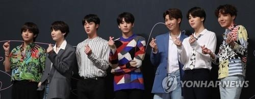 This photo shows BTS during a press conference in May 2018. (Yonhap)