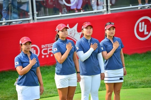 In this undated file photo provided by the LPGA Tour, members of the South Korean team at the 2016 UL International Crown stand for the national anthem before a match at Merit Club in Libertyville, Illinois. From left to right are Kim Sei-young, Chun In-gee, Amy Yang and Ryu So-yeon. (Yonhap)