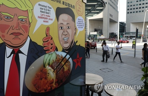 A local restaurant in Singapore launches a new menu item -- a bowl of rice and beef with kimchi -- on June 6, 2018, to mark the historic U.S.-North Korea summit slated for June 12. (Yonhap)
