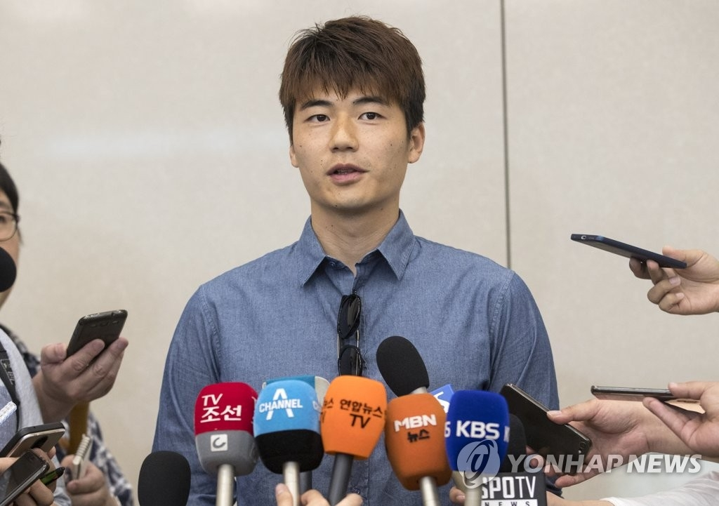 South Korean football player Ki Sung-yueng speaks to reporters at Incheon International Airport in Incheon on July 1, 2018. (Yonhap)