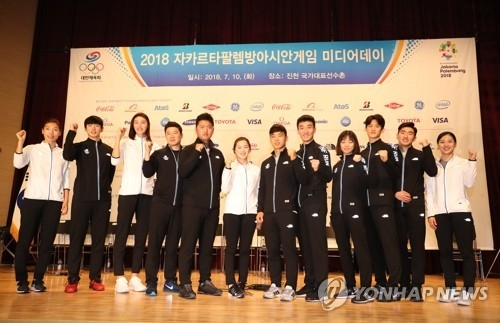 South Korean athletes for the 2018 Asian Games pose for a photo after a media event at the National Training Center in Jincheon, North Chungcheong Province, on July 10, 2018. (Yonhap)