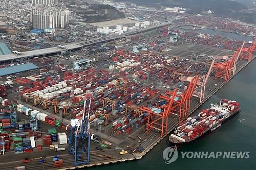 Containers carrying export goods are stacked on piers in Busan, South Korea's largest port city. (Yonhap)
