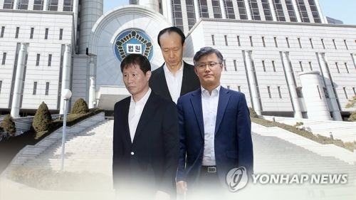 Two of ex-leader Park's 'doorknob trio' get prison terms for taking NIS money