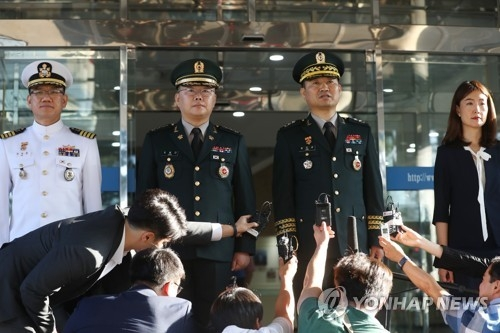 Major Gen. Kim Do-gyun (2nd from R), the chief of South Korea's delegation to the inter-Korean military talks, speaks to the press in Seoul on July 31, 2018, before departing for the border truce village of Panmunjom. (Yonhap)