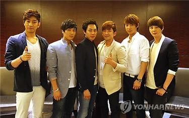 This file photo shows the six memebrs of Shinhwa. (Yonhap)