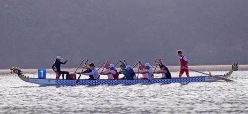 In this file photo from July 31, 2018, members of the unified Korean dragon boat racing team train at Chungju Tangeum Lake International Rowing Center in Chungju, 150 kilometers south of Seoul. (Yonhap)