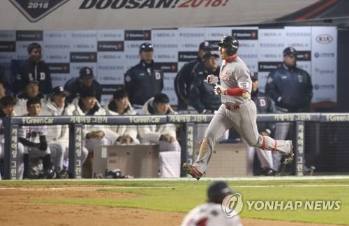 In this file photo from Nov. 12, 2018, Choi Jeong of the SK Wyverns celebrates his game-tying solo home run against the Doosan Bears in the top of the ninth inning of Game 6 of the Korean Series at Jamsil Stadium in Seoul. (Yonhap)