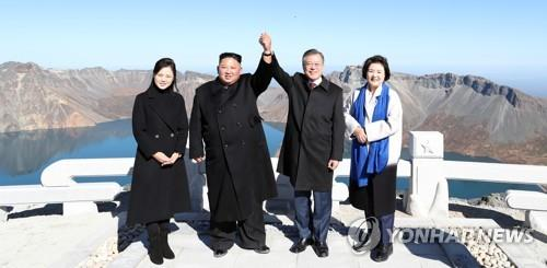 This file photo provided by the Korean Central News Agency on Sept. 21, 2018, shows the leaders of the two Koreas and their wives posing on top of Mount Paekdu, the highest mountain of the Korean Peninsula. (For Use Only in the Republic of Korea. No Redistribution) (Yonhap)