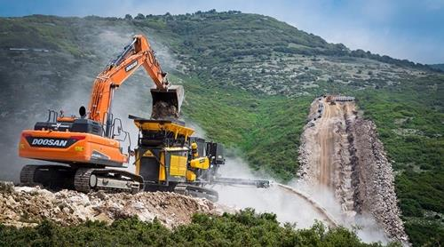 This photo provided by Doosan Infracore Co. shows its excavator working on a construction site in Europe. (Yonhap)