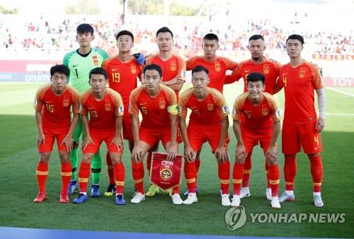 In this EPA photo, China national football team players pose before the AFC Asian Cup Group C match between China and Kyrgyzstan in Al Ain, the United Arab Emirates, on Jan. 7, 2019. (Yonhap)
