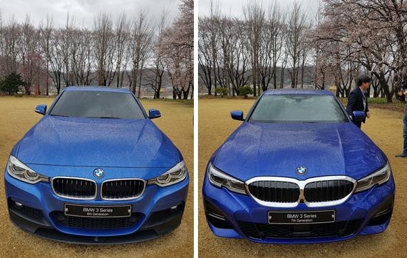 These photos taken on April 9, 2019, show the front sides of the sixth-generation BMW 320i model (L) and the seventh-generation BMW 330i model on display in Yangpyeong, 55 kilometers east of Seoul. (Yonhap)
