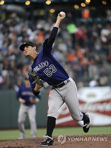 In this EPA file photo from May 14, 2012, Colorado Rockies starting pitcher Christian Friedrich releases a pitch against the San Francisco Giants during the bottom of the first inning of a Major League Baseball regular season game at AT&T Park in San Francisco. (Yonhap)
