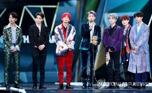 This photo of BTS taking the stage to accept an award at the 2018 MAMA in Hong Kong was provided by CJ ENM. (PHOTO NOT FOR SALE) (Yonhap)