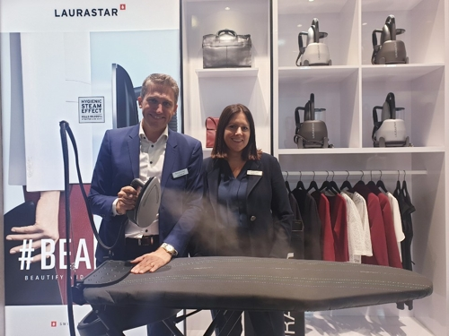 Michael Monney (L) and Julie Monney, co-CEOs of Swiss premium iron brand Laurastar, demonstrate their product during the IFA technology show held in Berlin from Sept. 6-11, 2019. (Yonhap)