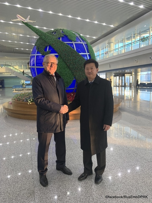 Jo Chol-su (R), director-general of the North American department at the North's foreign ministry, poses for photo with Ambassador to North Korea Alexander Matsegora at Pyongyang's Sunan International Airport on Nov. 4, 2019, before departing for Moscow to attend the Moscow Nonproliferation Conference, in this photo provided by the Russian Embassy in Pyongyang on its Facebook account. (PHOTO NOT FOR SALE) (Yonhap)