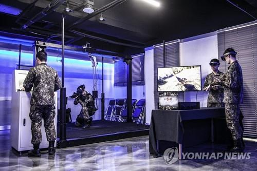 Wearing virtual reality devices, cadets of the Korea Military Academy receive tactical training at a virtual space in this photo provided by top mobile carrier SK Telecom Co. on April 15, 2019. The two sides will sign a business tie-up to make the academy smart based on 5G technology. (Yonhap)