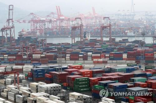 The file photo, taken Dec. 1, 2019, shows stacks of export-import containers at South Korea's largest port in Busan, located some 450 kilometers south of Seoul. (Yonhap)