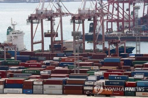 This undated file photo shows containers carrying export goods in the southeastern city of Busan, South Korea's largest seaport. (Yonhap)