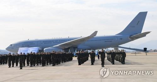 In the file photo taken Jan. 30, 2019, members of an Air Force unit salute during a ceremony at an air base in the southeastern city of Gimhae to mark the introduction of a KC-330 aerial tanker, the country's first aerial refueling aircraft, before its deployment in 2020. (Yonhap)