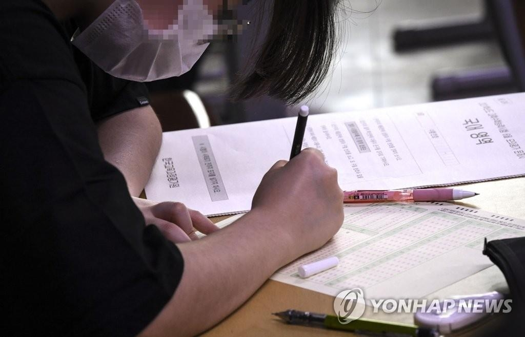 The file photo taken June 18, 2020, shows a student taking a practice university entrance exam. (Yonhap)