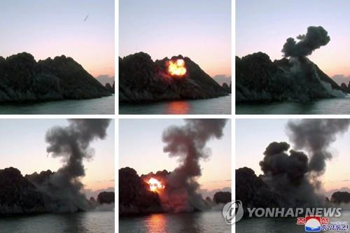 "This combined photo, released by North Korea's official Korean Central News Agency on March 30, 2020, shows the North testing ""super-large"" multiple rocket launchers the previous day. The report came one day after South Korea's military said the North fired what appeared to be two short-range ballistic missiles. The KCNA did not mention whether leader Kim Jong-un had observed the launch, nor did it elaborate on other details on the weapon and the place where the test was conducted. (For Use Only in the Republic of Korea. No Redistribution) (Yonhap)"