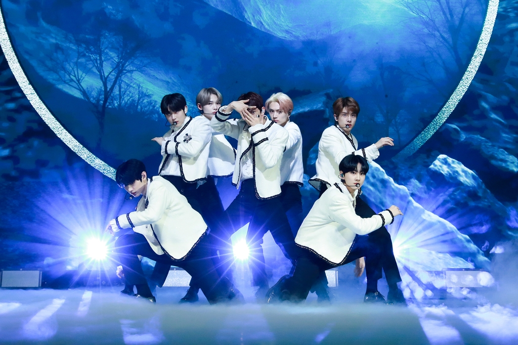 "This photo, provided by Belift Lab, shows members of rookie boy band ENHYPEN performing lead track ""Given-Taken"" during a media showcase held online on Nov. 30, 2020. (PHOTO NOT FOR SALE) (Yonhap)"