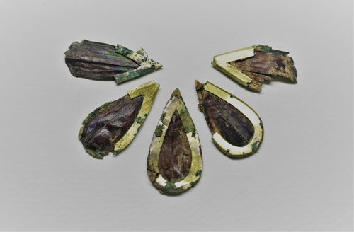 This photo, provided by the Gyeongju National Research Institute of Cultural Heritage on Dec. 7, 2020, shows jewel beetle ornaments that were found at Tomb No. 44 at Jjoksaem in Gyeongju, South Korea. (PHOTO NOT FOR SALE) (Yonhap)