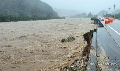 Part of a road in Gangwon Province, east of Seoul, is destroyed due to Typhoon Haishen on Sept. 7, 2020, in this photo provided by the Yangyang County Office. (PHOTO NOT FOR SALE) (Yonhap)