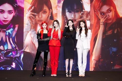 This file photo, provided by SM Entertainment, shows K-pop act aespa posing during an online news conference on May 17, 2021. (PHOTO NOT FOR SALE) (Yonhap)