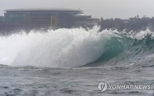Strong winds cause big waves in waters off Jeju, South Korea, on Aug. 23, 2021, as Typhoon Omais approaches the southern resort island. (Yonhap)