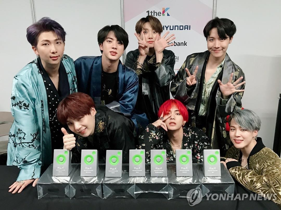 South Korean boy group BTS poses for photographers in this image captured from BTS member V's Instagram account on Dec. 4, 2018. (Yonhap)