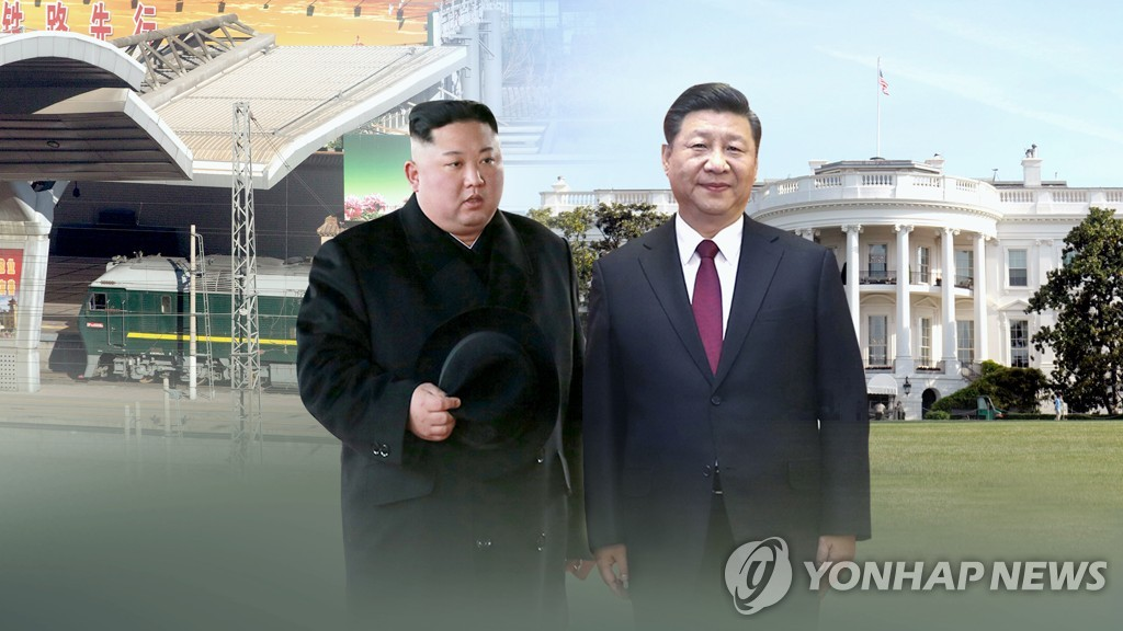 This image, provided by Yonhap News TV, shows Chinese President Xi Jinping (R) and North Korean leader Kim Jong-un. (Yonhap)