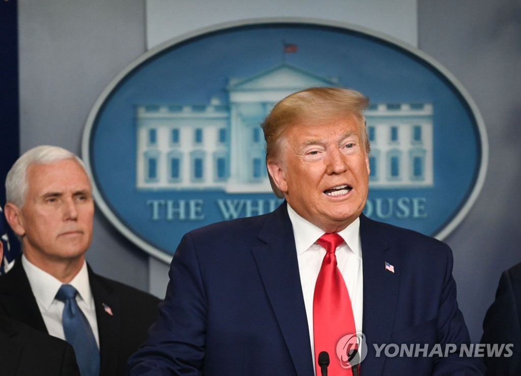 This AFP photo shows U.S. President Donald Trump speaking during a press conference on the coronavirus as U.S. Vice President Mike Pence looks on at the White House in Washington on Feb. 29, 2020. (Yonhap)