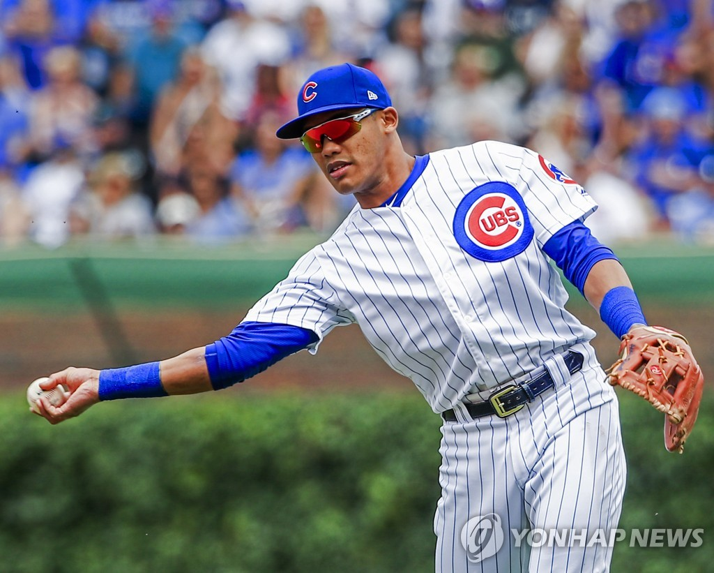 In this EPA file photo, from June 21, 2019, Chicago Cubs' second baseman Addison Russell makes a throw to first base during the bottom of the first inning of a Major League Baseball regular season game against the New York Mets at Wrigley Field in Chicago. (Yonhap)