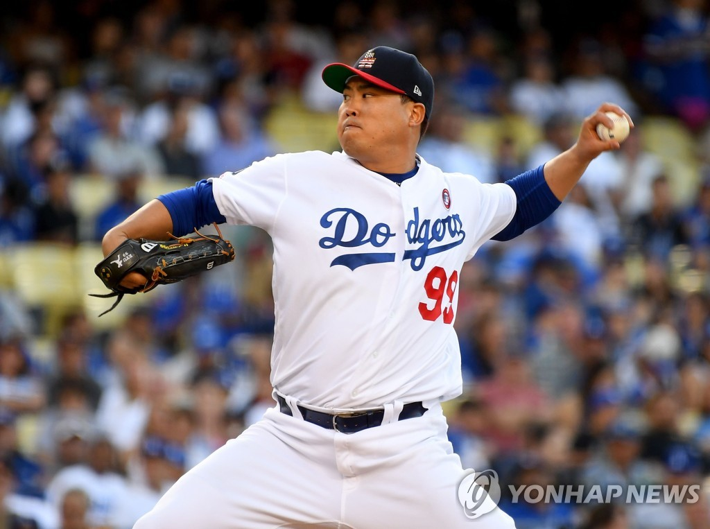 In this Getty Images file photo from July 4, 2019, Ryu Hyun-jin of the Los Angeles Dodgers delivers a pitch against the San Diego Padres in the top of the third inning of a Major League Baseball regular season game at Dodgers Stadium in Los Angeles. (Yonhap)