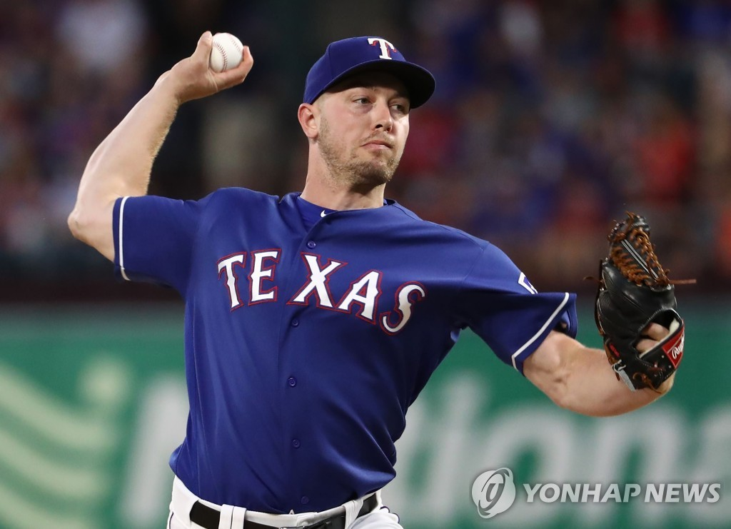 In this Getty Images file photo from July 12, 2019, Adrian Sampson of the Texas Rangers throws against the Houston Astros in the top of the seventh inning of a Major League Baseball regular season game at Globe Life Park in Arlington, Texas. (Yonhap)
