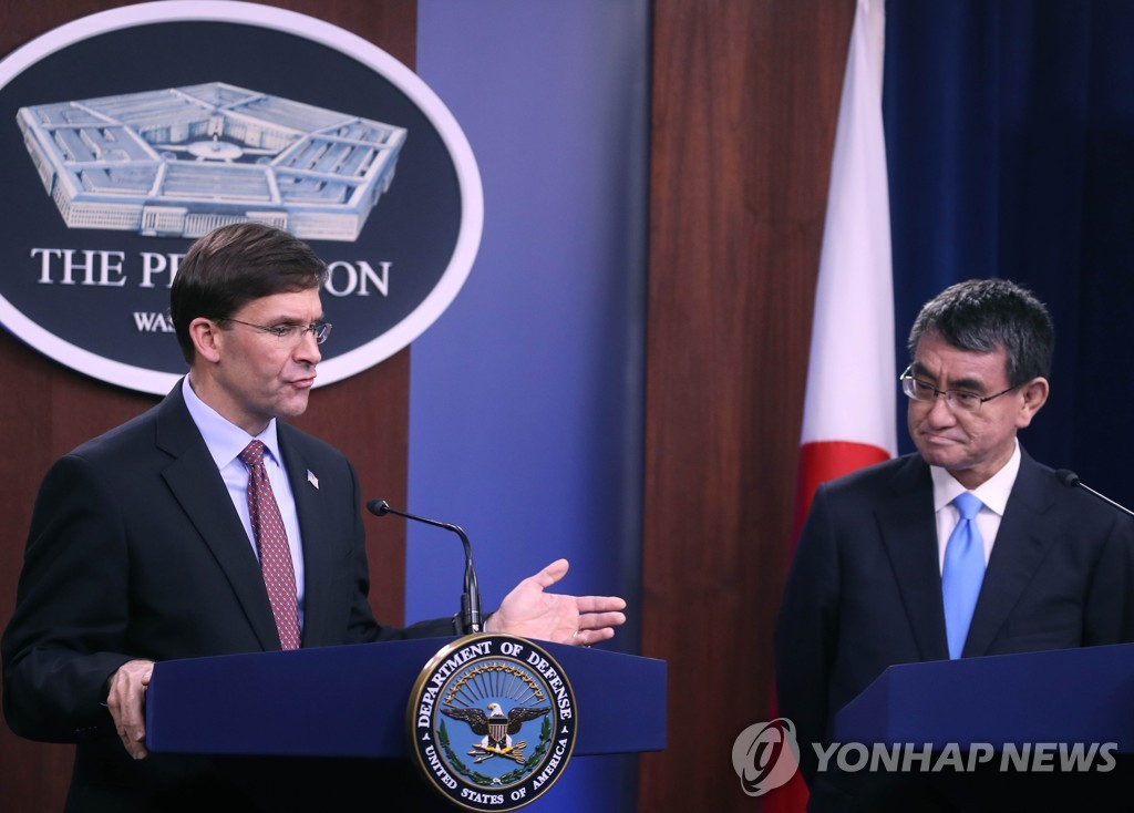 This AFP photo shows U.S. Secretary of Defense Mark Esper (L) and Japanese Defense Minister Taro Kono speaking to the media at the Pentagon in Arlington, Virginia, on Jan. 14, 2020. (Yonhap)