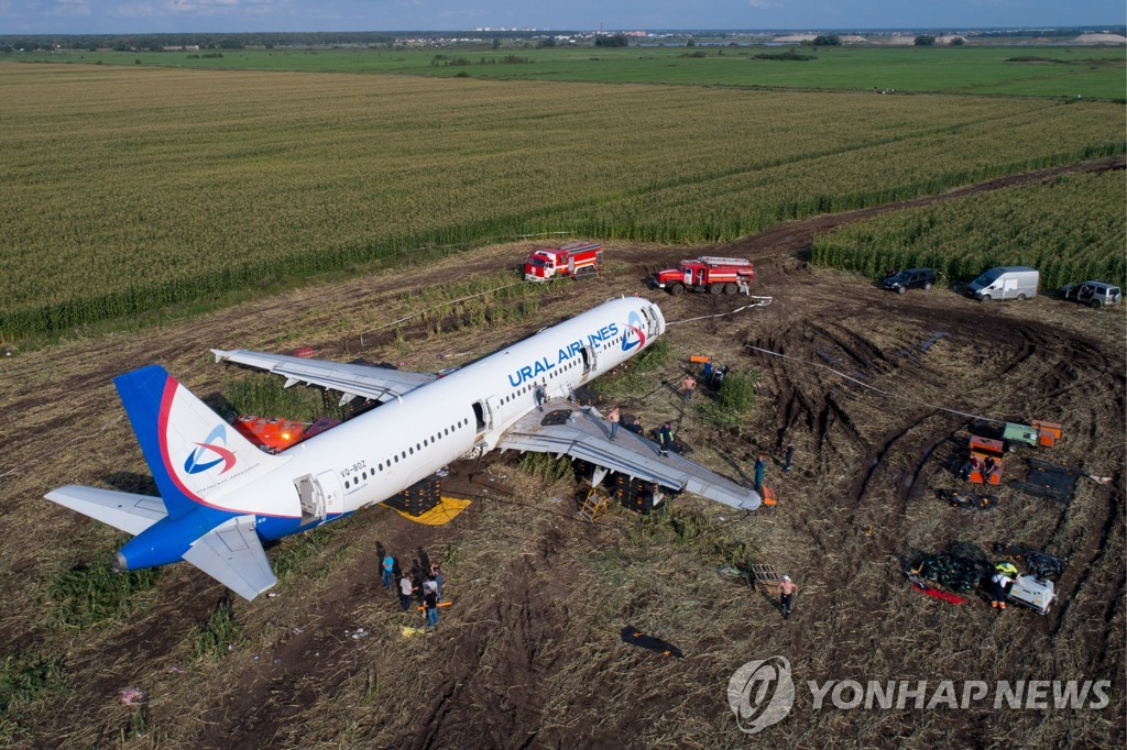 Dismantling Airbus A321 jet at crash landing site near Zhukovsky Airport